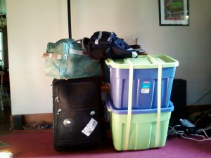 Two totes, a suitcase, a smaller bag, and a backpack