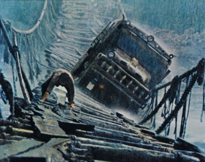 Painting of a huge truck attempting to cross a rickety wooden bridge as a man stands in front, apparently repairing the boards.