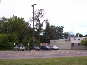 The University of Rochester Building 520 parking lot shows all but one car parked in handicapped-accessible spaces.