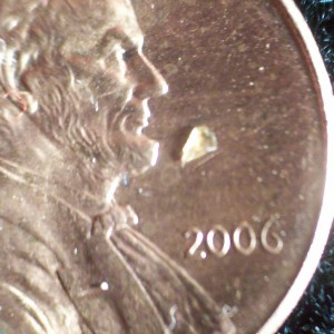 "a shard of glass as large as the ""20"" in ""2006"" on a penny"